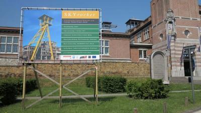 VanGerven VanRijnberk, SKYrocket, Billboard Project announcement at C-Mine Genk, Manifesta 9. digital photograph